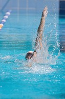 Young australian athlete doing backstroke