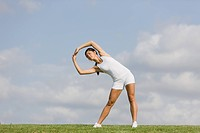 Woman Exercising and stretching arms