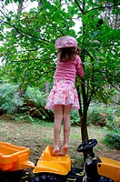 Little girl apple tree