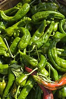 Close_up of green chili peppers at a farmer´s market