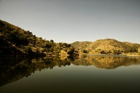Reflection of mountain in a lake, Udaipur, Rajasthan, India