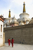 Two monks walking in a monastery, Lamayuru Monastery, Ladakh, Jammu and Kashmir, India