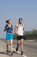 Couple jogging at the roadside