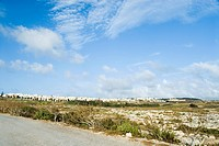 Road with a township in the background, Malta