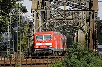 Train on railroad track, Deutschherrnbruecke, Frankfurt, Hesse, Germany