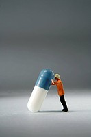 little man and pill