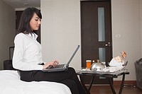 Asian businesswoman working in hotel room