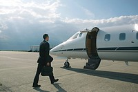 Businessman boarding a private airplane
