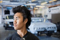 Asian man in auto body shop