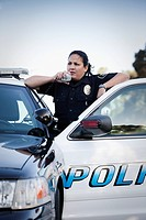 Hispanic policewoman talking on CB radio (thumbnail)