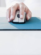 Woman clicking on computer mouse (thumbnail)