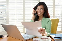 Korean businesswoman working at desk