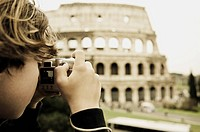 Young Boy Taking Pictures of the Coliseum in Rome