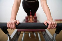 Woman exercising on Pilates bench