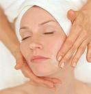 Woman receiving a facial treatment at a beauty spa