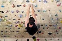 High angle view of a man indoor rock climbing