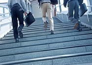 Businessmen walking up stairs