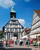 Germany, Uslar, Schwuelme, Ahle, Solling, Weserbergland, Lower Saxony, city hall with clock tower, half-timbered houses, pedestrian zone, people, chil...