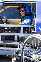Smiling male disability auto racer
