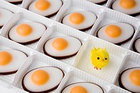 Sweet eggs and chick in a tray