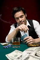 A man at a high stakes poker game looking suspicious