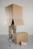 A person standing with a box over his head
