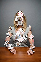 A young woman with cards stuck all over her