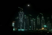 Skyscapers being constructed at night, Dubai, UAE