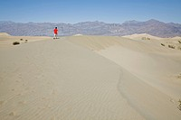 A person walking along a sanddune, Death Valley, California, USA