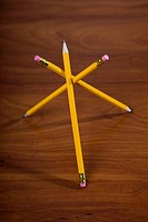 Three pencils balanced against each other