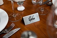A No Smoking sign on a dining table