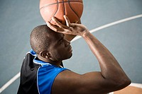 A man preparing to shoot a basketball