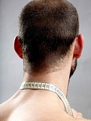 Rear view of a man with a tape measure around his neck