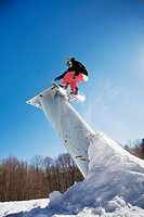 A snowboarder mid_air, Stratton, Vermont, USA
