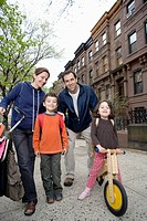 A family standing together on a sidewalk, Brooklyn, New York City