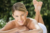 Smiling young woman at health spa