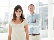 Woman and businessman standing in office