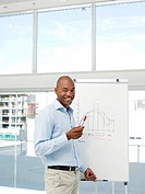 Businessman drawing graph for presentation