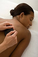 Woman having stone massage