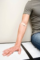 Man with plaster on arm