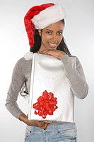 Young woman holding a christmas gift (thumbnail)