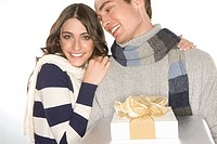Young couple holding gifts (thumbnail)