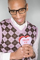 Nerdy man holding a love heart (thumbnail)