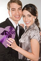 Romantic couple holding a heart shaped box (thumbnail)
