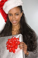 Woman with a gift and a santa hat