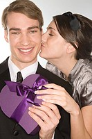 Romantic couple holding a gift