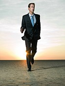 Businessman running in the desert