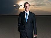 Businessman standing in the desert