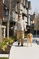 Blind man with a golden retriever