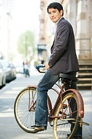 Male office worker on a bicycle